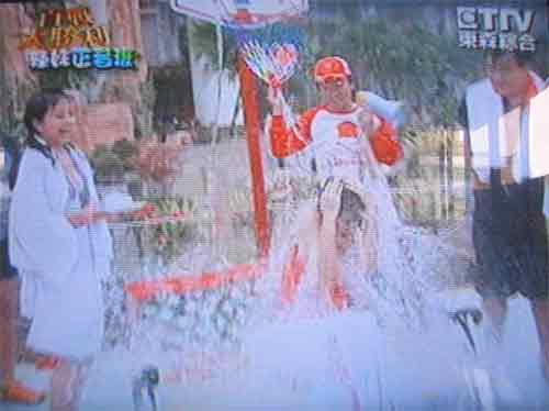 unsuccessful TV show contestant is doused with water