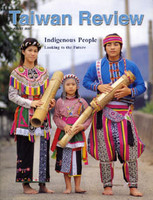 cover of Taiwan Review, featuring a man, woman, and child in traditional aboriginal (Amis) dress