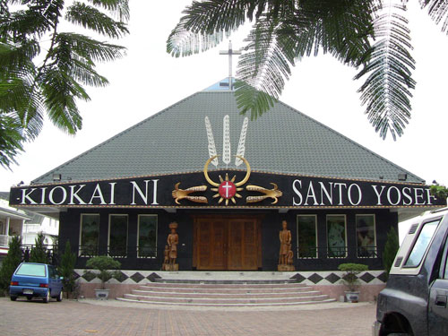 photo of a church, with 'KIOKAI NI' and 'SANTO YOSEF' written on it in large letters